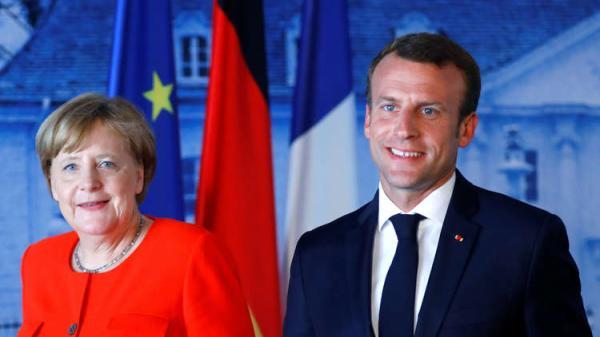 ميركل وماكرون: تحدي الهجرة يتطلب ردا أوروبيا مشتركا