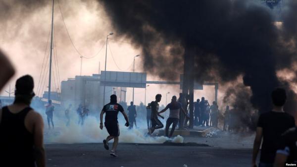 مسؤولان عراقيان: قناصة لميليشيات مدعومة من إيران أطلقوا النار على المتظاهرين