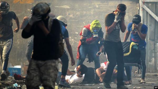 """""""ليسمع العالم صرختنا"""".. الرصاص يذبح العراقيين (فيديو )"""